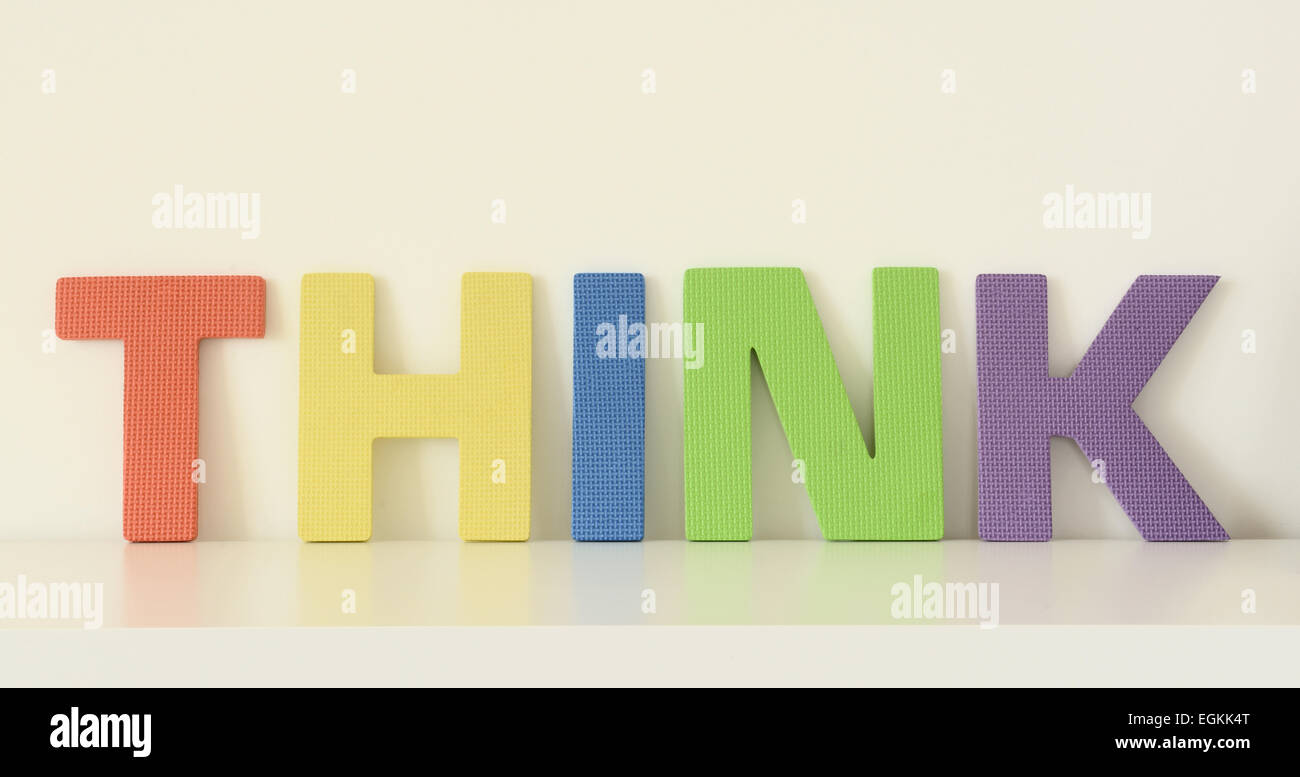 Word THINK In Colorful Upper Case Letters Of Foam Toys On White Surface