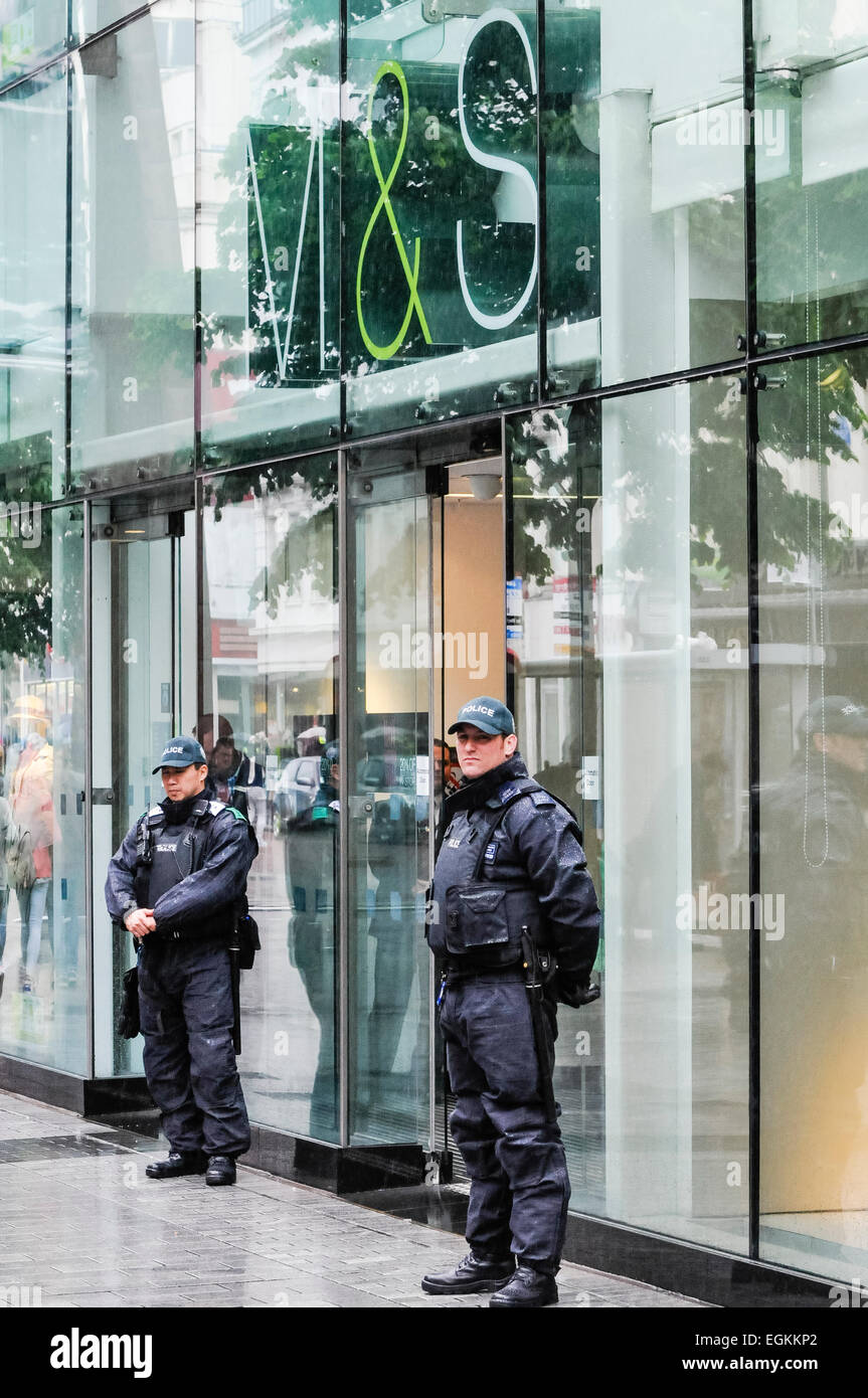 Belfast, Northern Ireland, 15th june 2013. Two police officers guard a branch of Marks and Spencer from potential - Stock Image