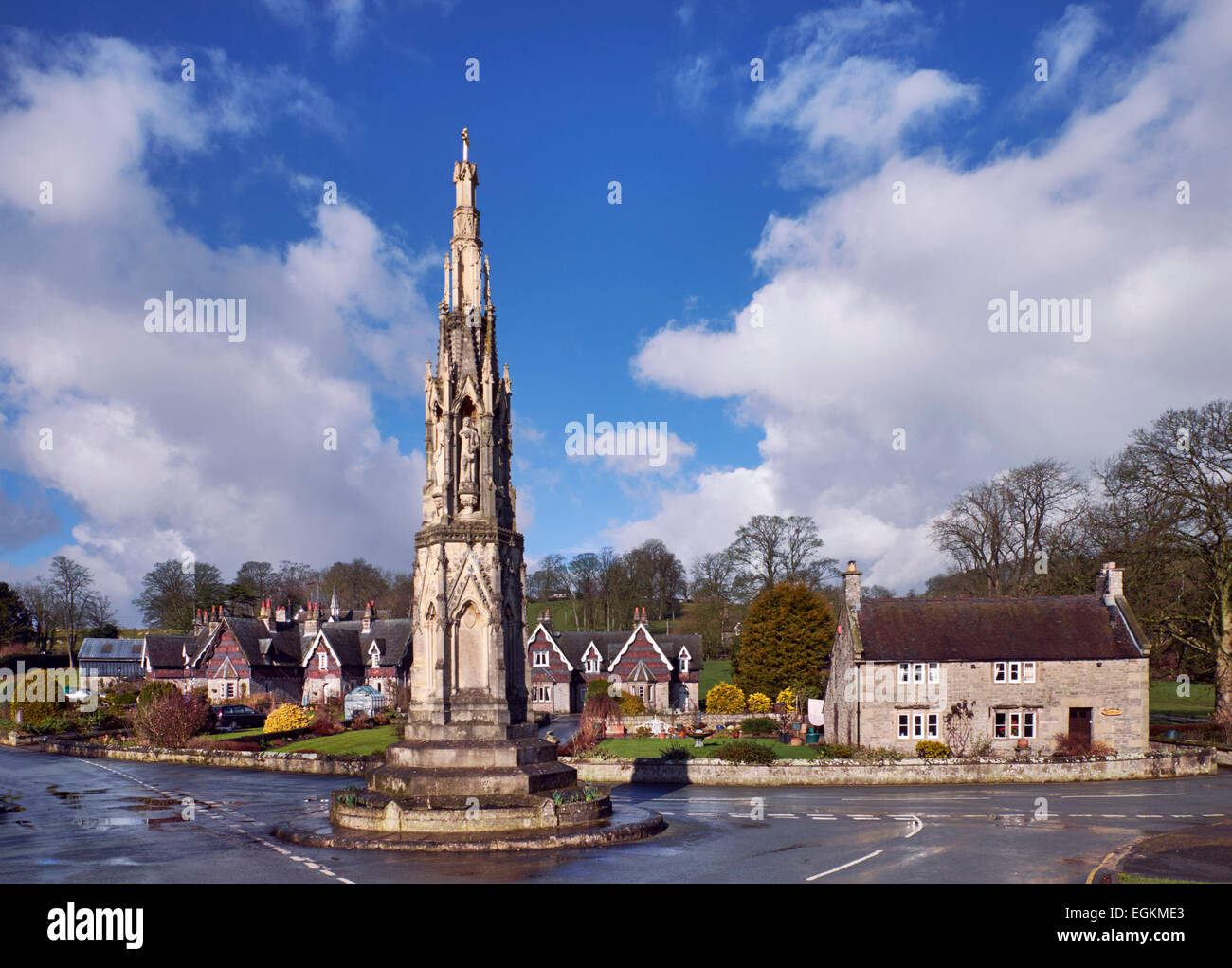 The Mary Watts Russell Memorial Cross and Swiss-style cottages in the village of Ilam. Staffordshire, England. [Peak - Stock Image