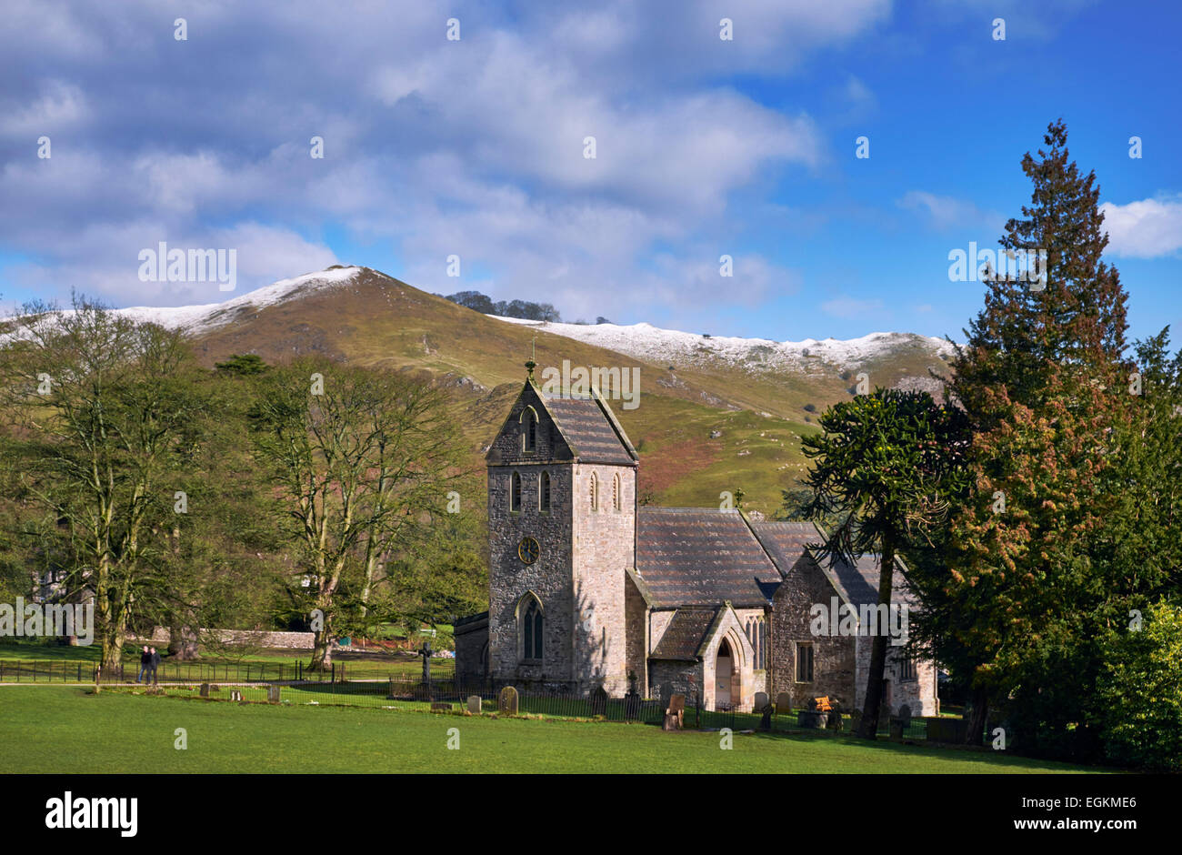 Church of the Holy Cross in Ilam Park with Bunster Hill beyond. Ilam, Staffordshire, England.  [Peak District National - Stock Image