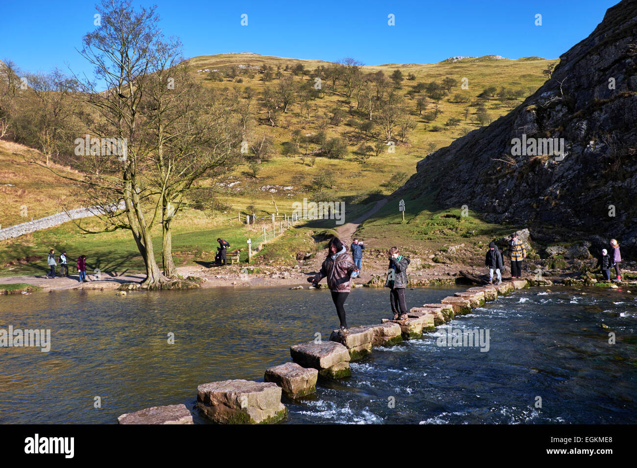 People on the famous Stepping Stones across the River Dove. Dovedale, Derbyshire, England.  [Peak District National - Stock Image