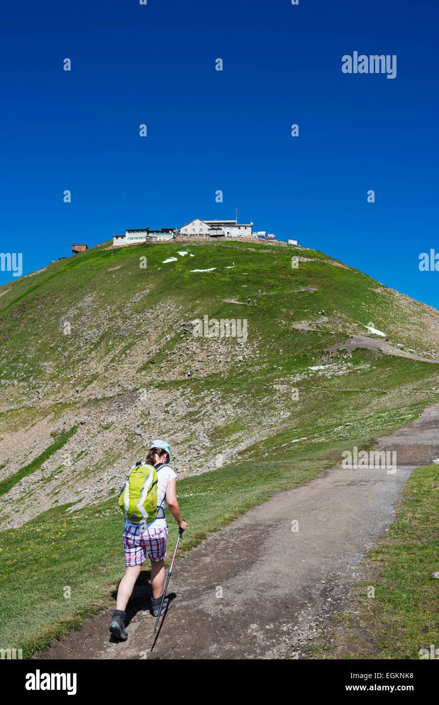 Europe, Switzerland, Swiss Alps Jungfrau-Aletsch Unesco World Heritage site, hiker below a mountain refuge - Stock Image