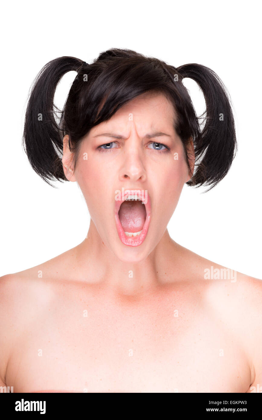Portrait of beautiful young woman shouting, humorous facial expression, isolated on white - Stock Image