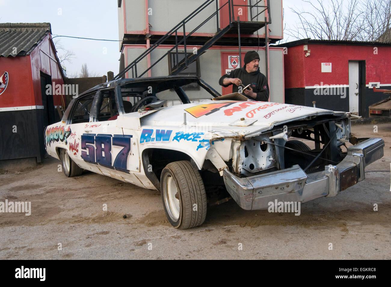 old smashed up Cadillac at a demo derby destruction derbies banger race racing races junk scrap american large big - Stock Image
