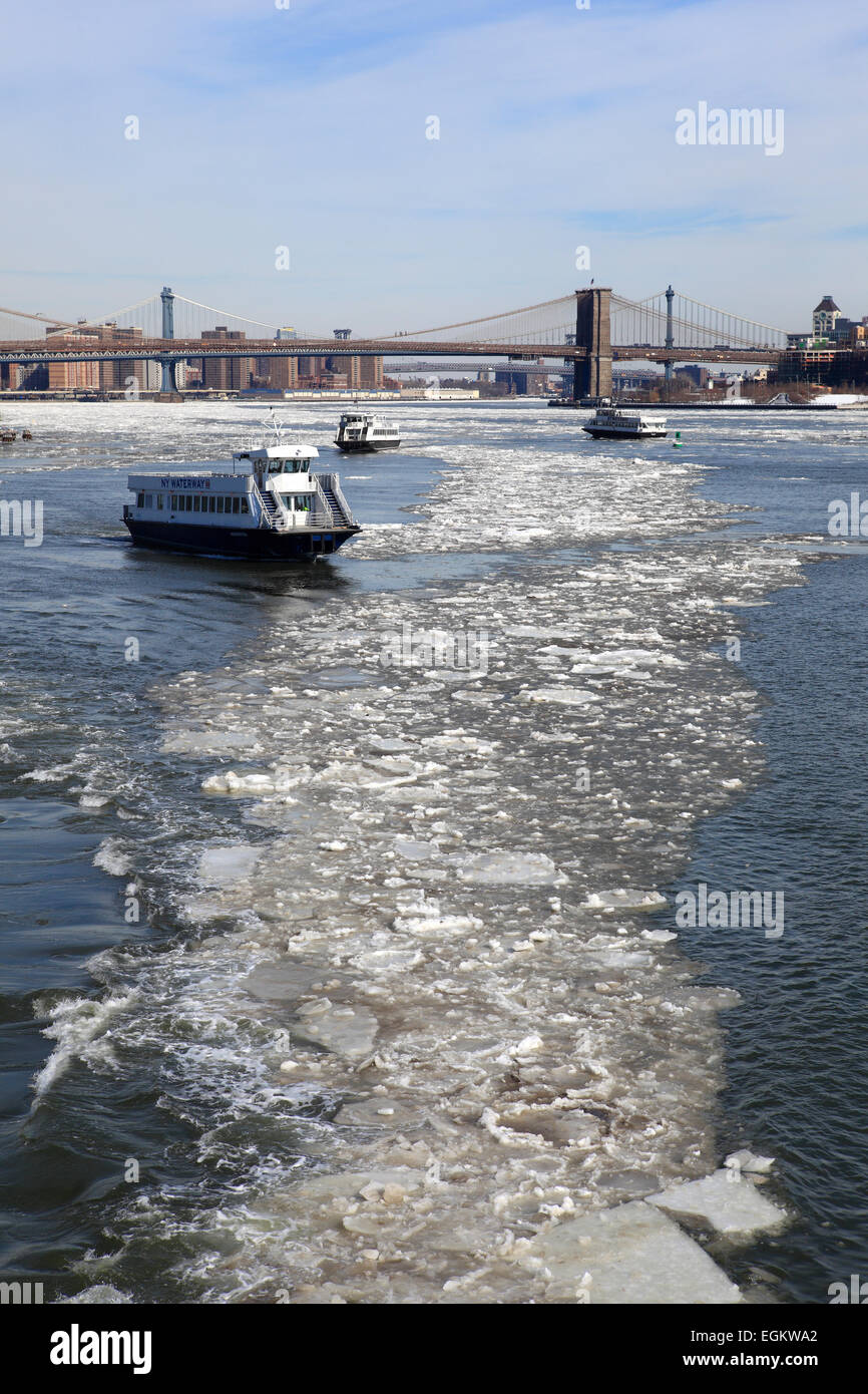 Ferryboats navigating frozen Eastriver in New York City - Stock Image