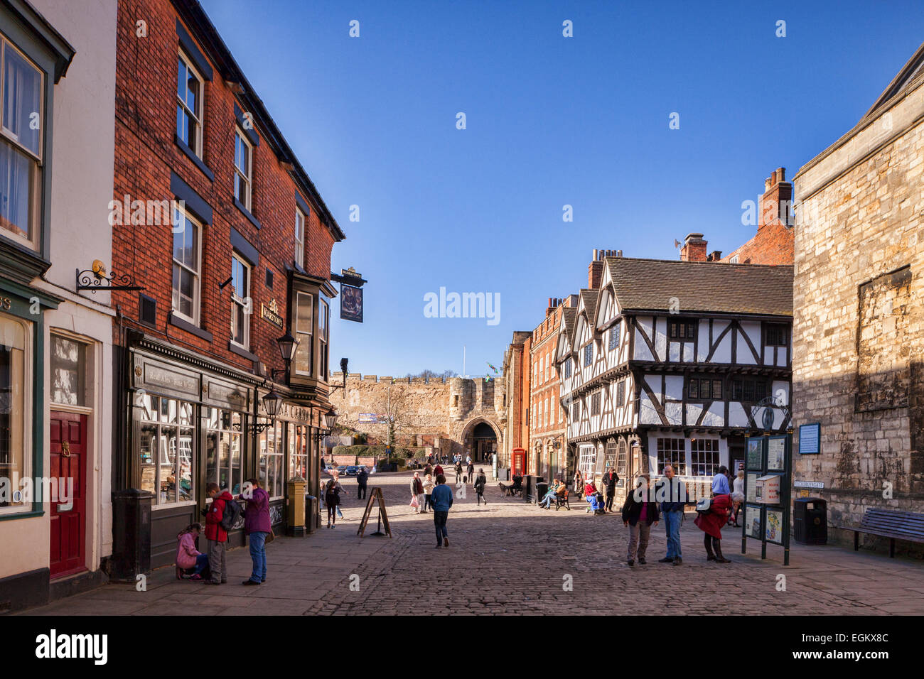 A view of the centre of Lincoln, Lincolnshire, England, UK, with Castle Hill and Exchequergate, the Magna Carta - Stock Image