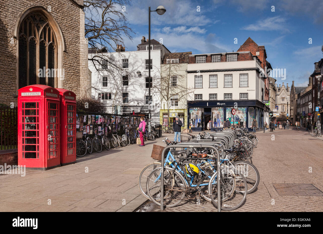 Cambridge street scene - St Andrew's Street, with bicycles, red English telephone boxes, shops and old buildings. - Stock Image