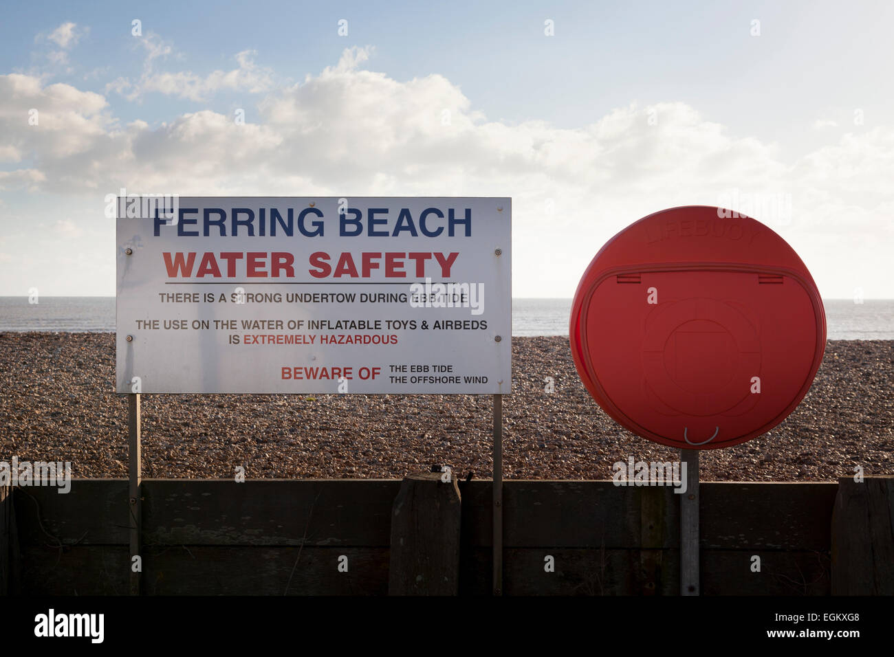 Ferring beach water safety sign and lifebuoy ring housing Stock Photo