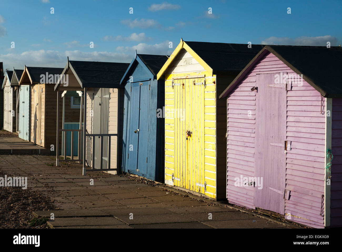Row of colourful painted beach huts without people Stock Photo