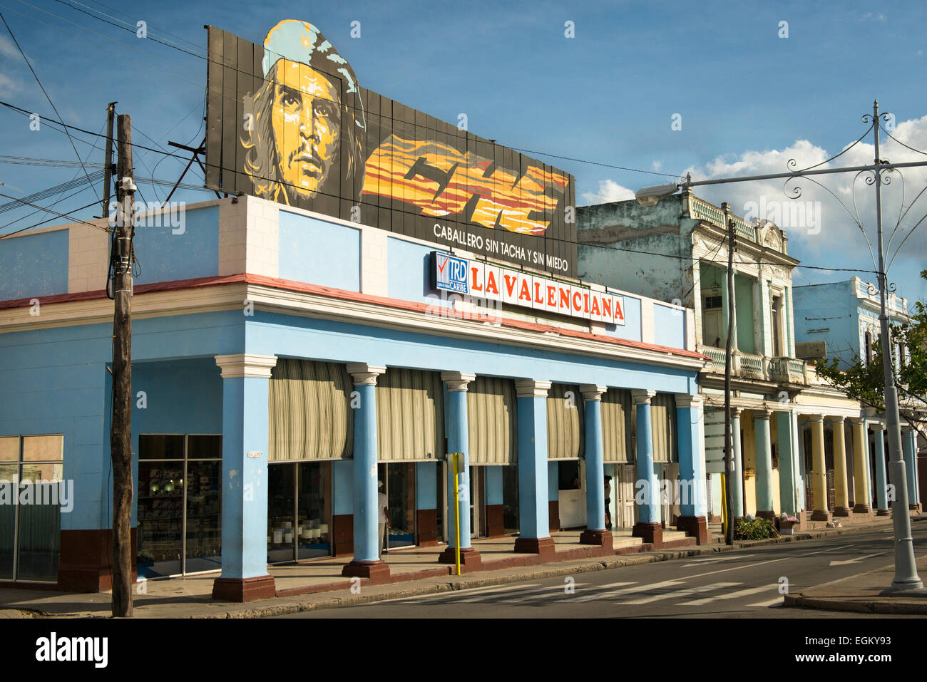 Cuba Cienfuegos typical arcade colonade consumer goods electrical appliances shop store La Valenciana billbord CHE Stock Photo
