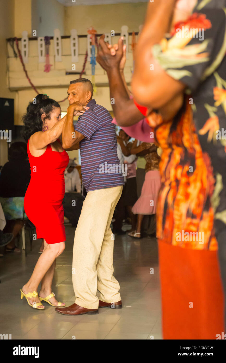 Cuba Cienfuegos church hall old people pensioners afternoon salsa dance ball younger man woman couple dancing dancer - Stock Image