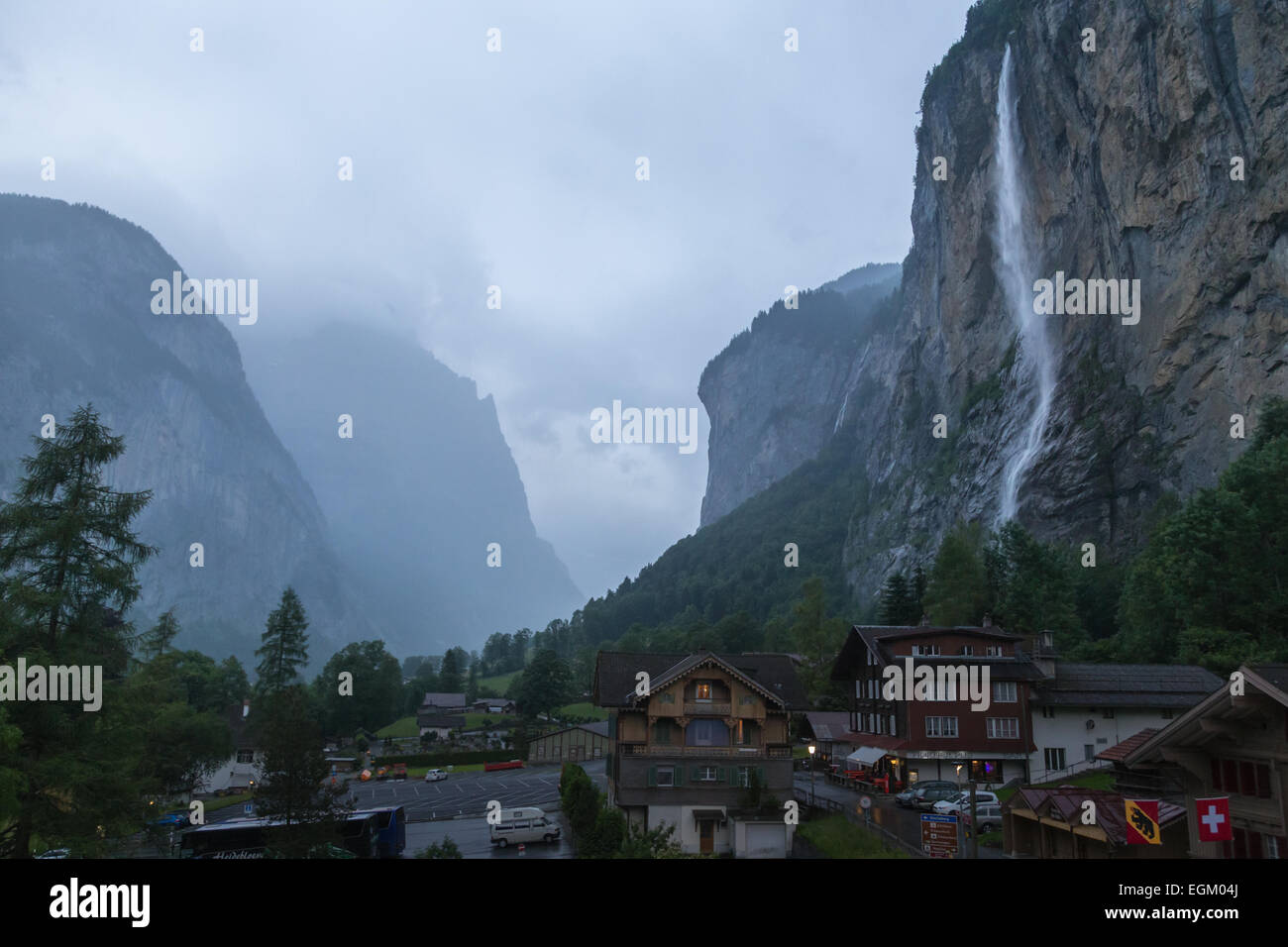 Stabbach Falls contrasts against the dark storm clouds  and rain moving through Lauterbrunnen Valley, Switzerland Stock Photo