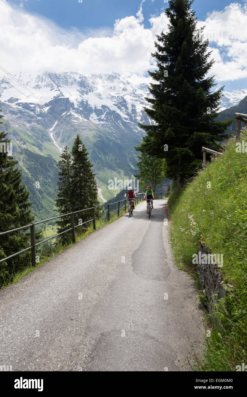 Scenic views along the hiking and bicycling trail connecting Grutschalp and Gimmelwald, Switzerland in Bernese Oberland - Stock Image