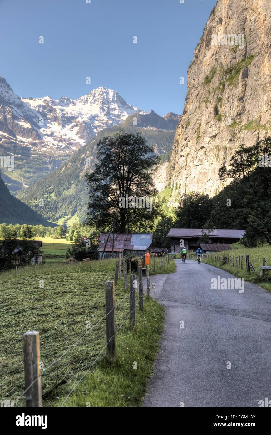 Bicycling through the Lauterbrunnen Valley, Switzerland - Stock Image