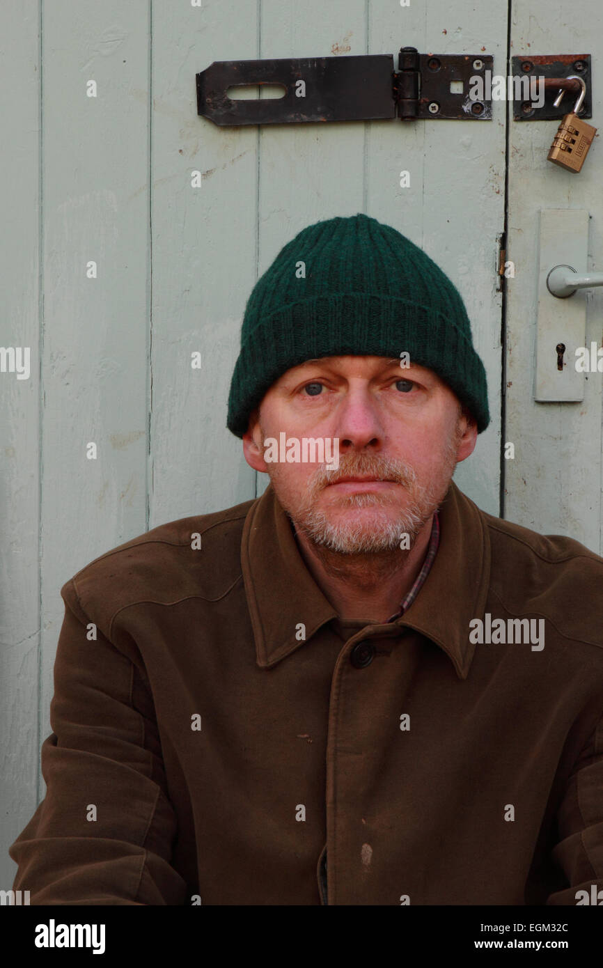 Portrait Of Middle Aged Man Aged 50 Years Old Wearing Working