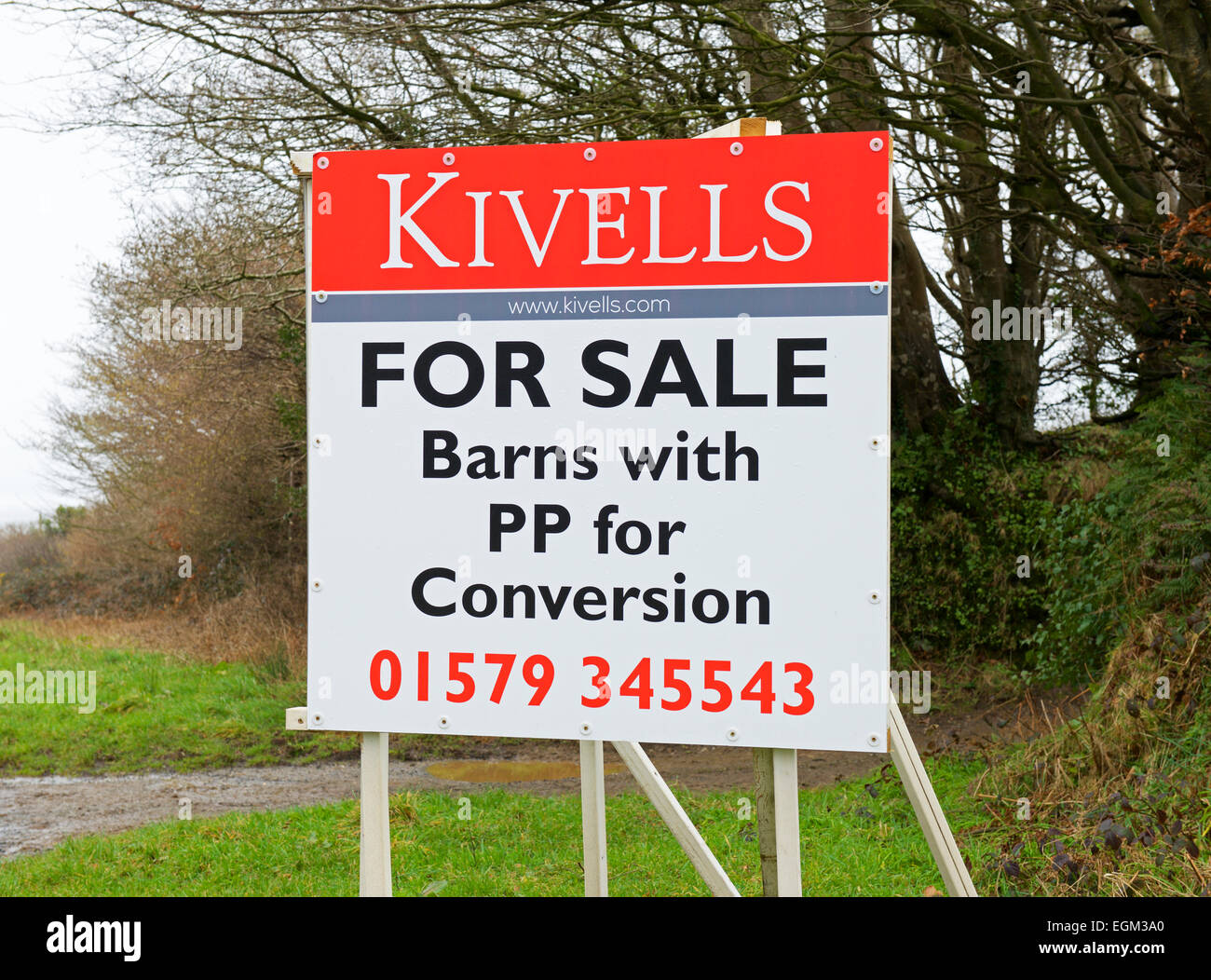 Sign: Barns for sale with planning permission for conversion, Cornwall, England UK - Stock Image