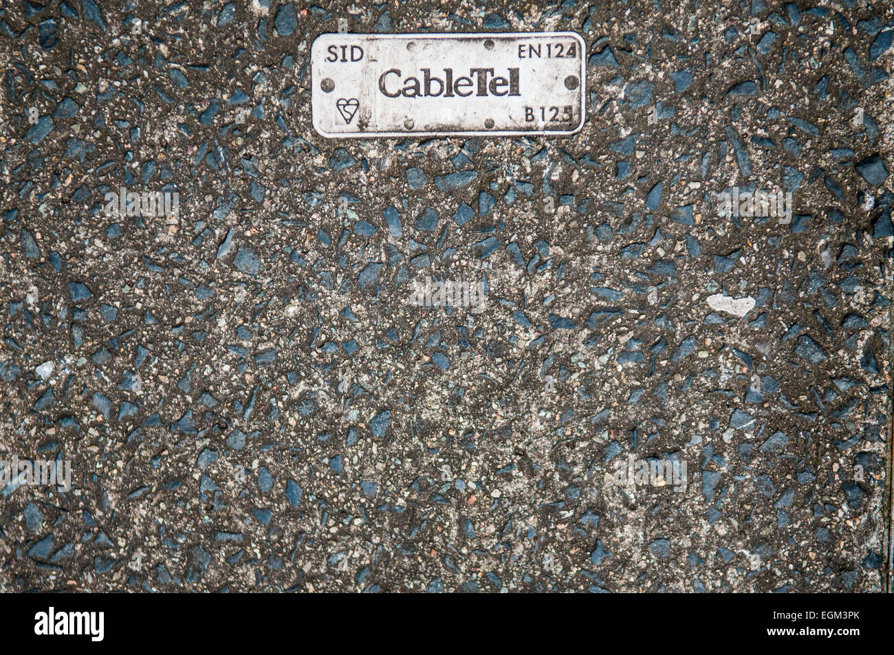 CableTel badge on a manhole cover - Stock Image