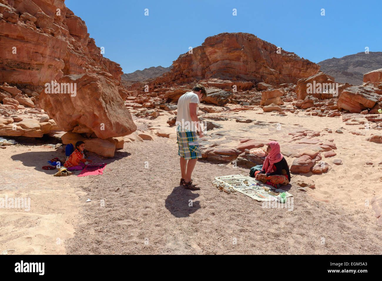 Bedouin kids selling souvenirs in Colored Canyon, Sinai, Egypt. Coloured Canyon is a rock formation and dried riverbed - Stock Image