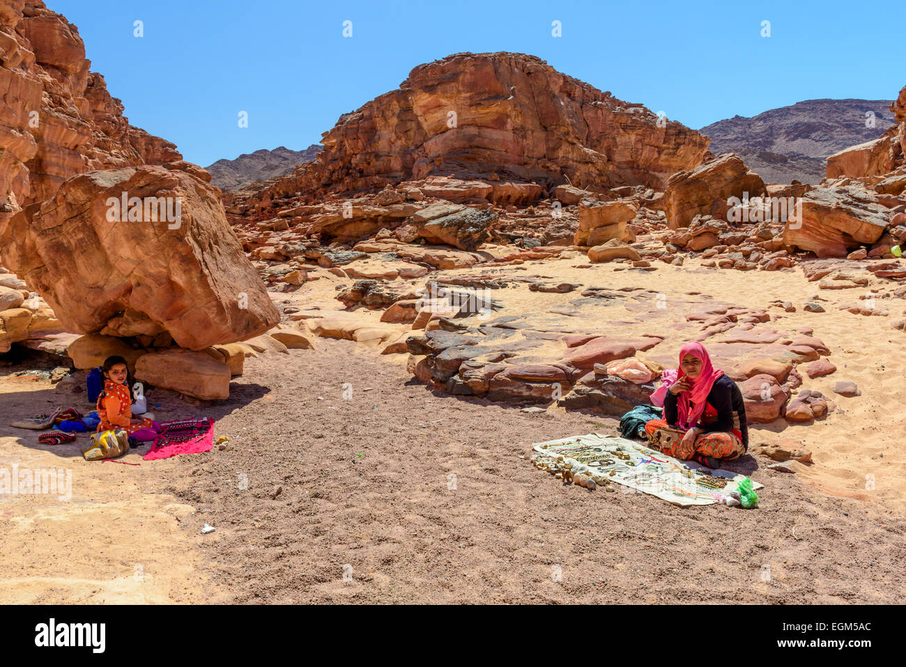 Bedouin kids selling souvenirs in Colored Canyon, Sinai, Egypt. Coloured Canyon is a rock formation and dry riverbed - Stock Image