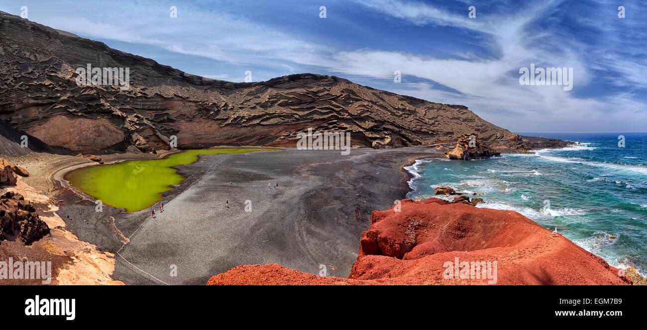 Charco de los Clicos. Timanfaya National Park in Lanzarote island. Beach in the volcano crater. Colorful lava palette. - Stock Image