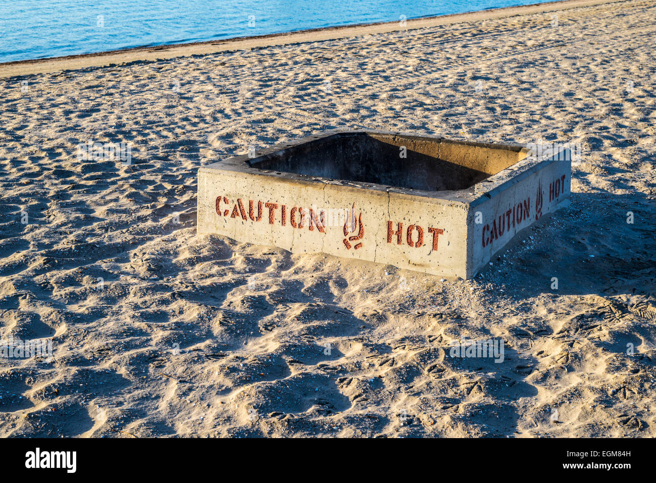 Caution Hot sign on firepit on a beach. San Diego, California, United States - Fire Pits On The Beach Stock Photos & Fire Pits On The Beach Stock