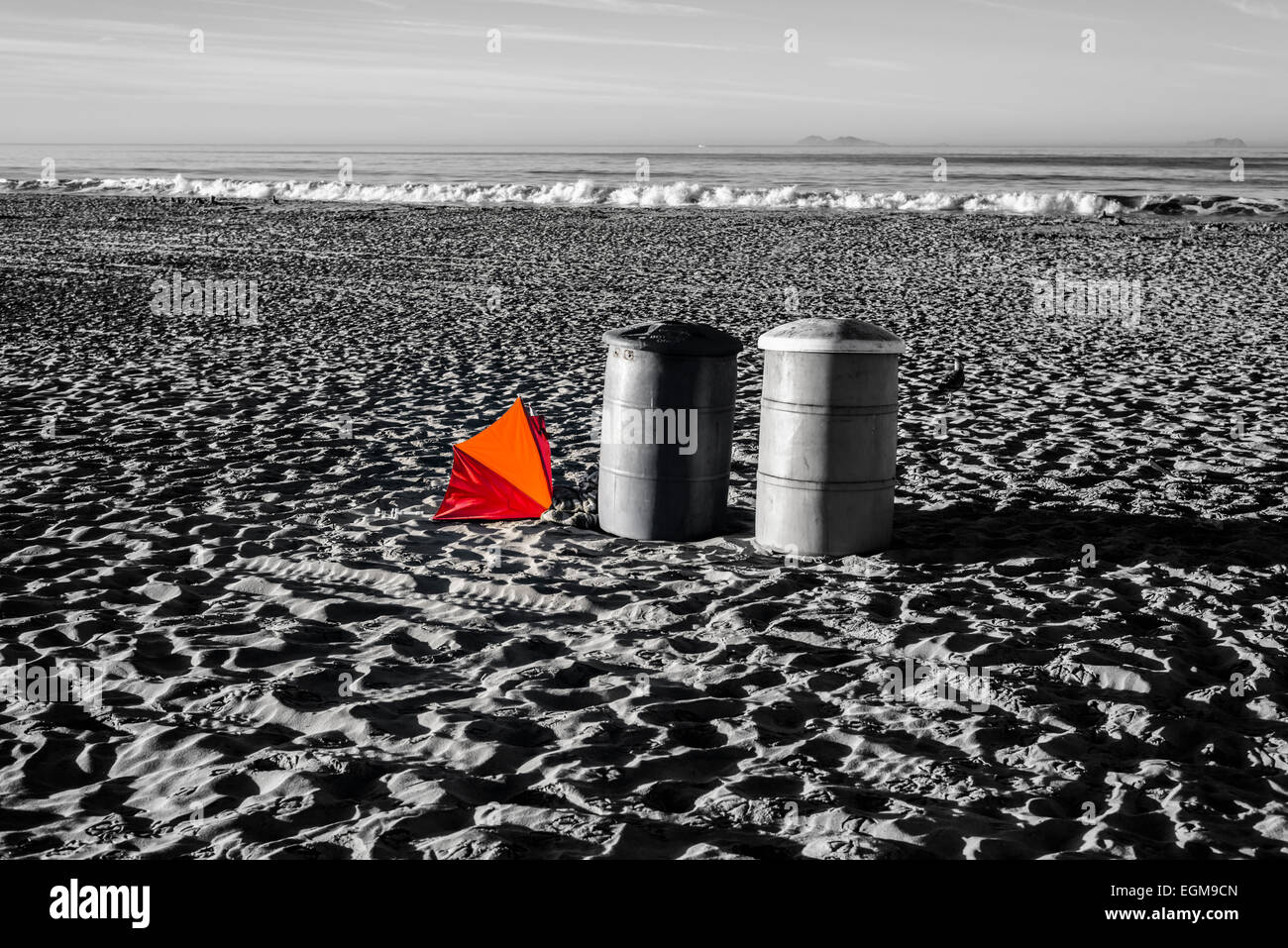 Two trash cans and a beach umbrella on Coronado Central Beach. Coronado,  California, United States. - Stock Image