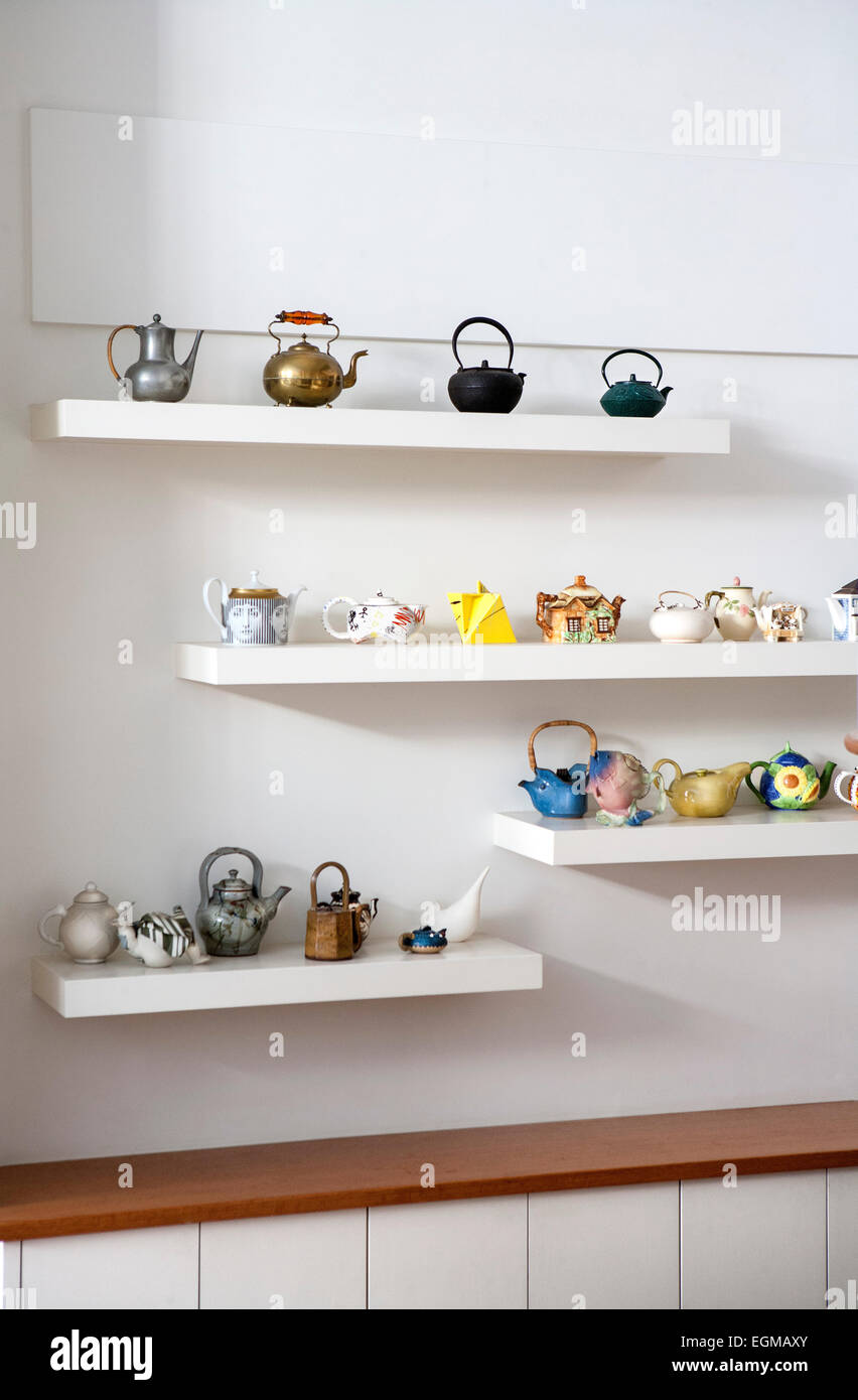 Collections of Teapots on Wall Shelves - Stock Image