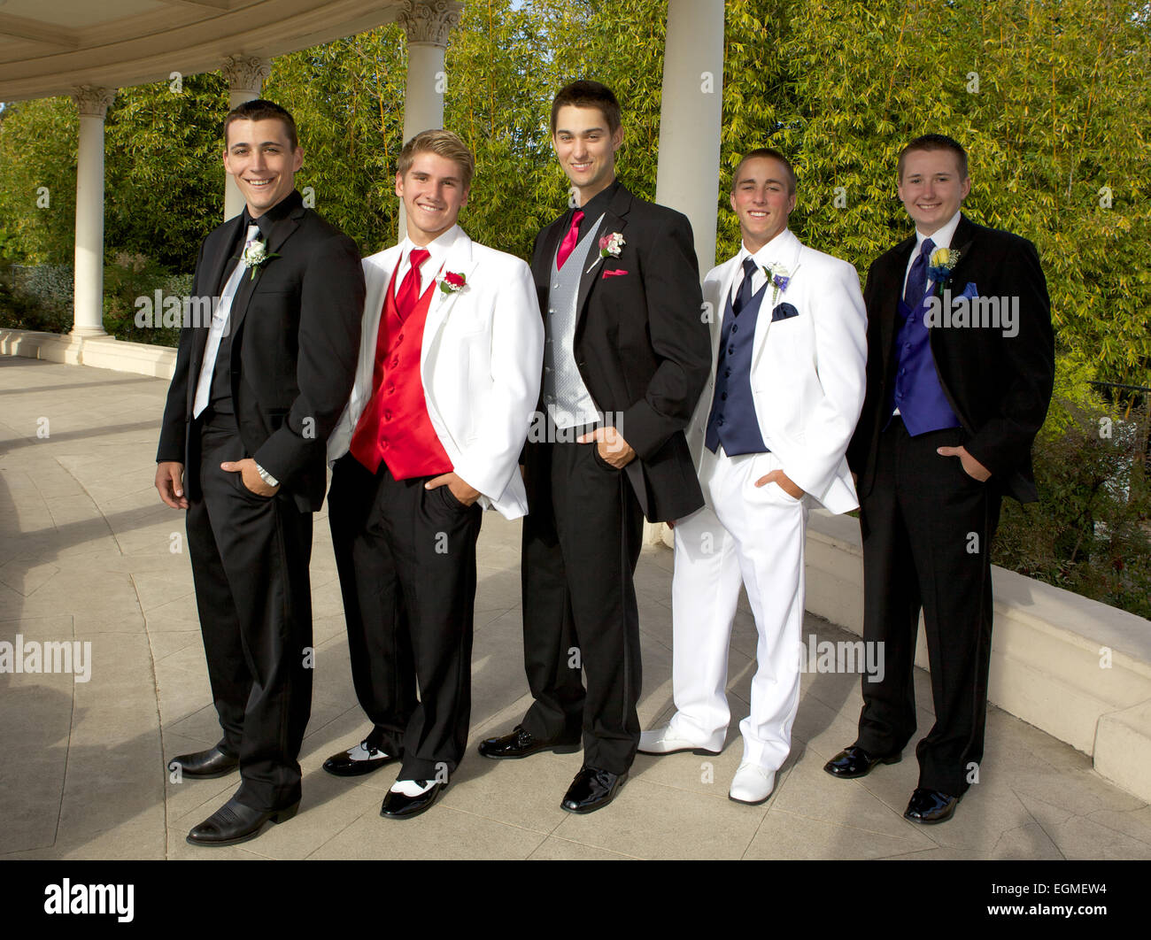Five Handsome Teenage Boys in Tuxedos Posing for a Prom Photo Outside - Stock Image