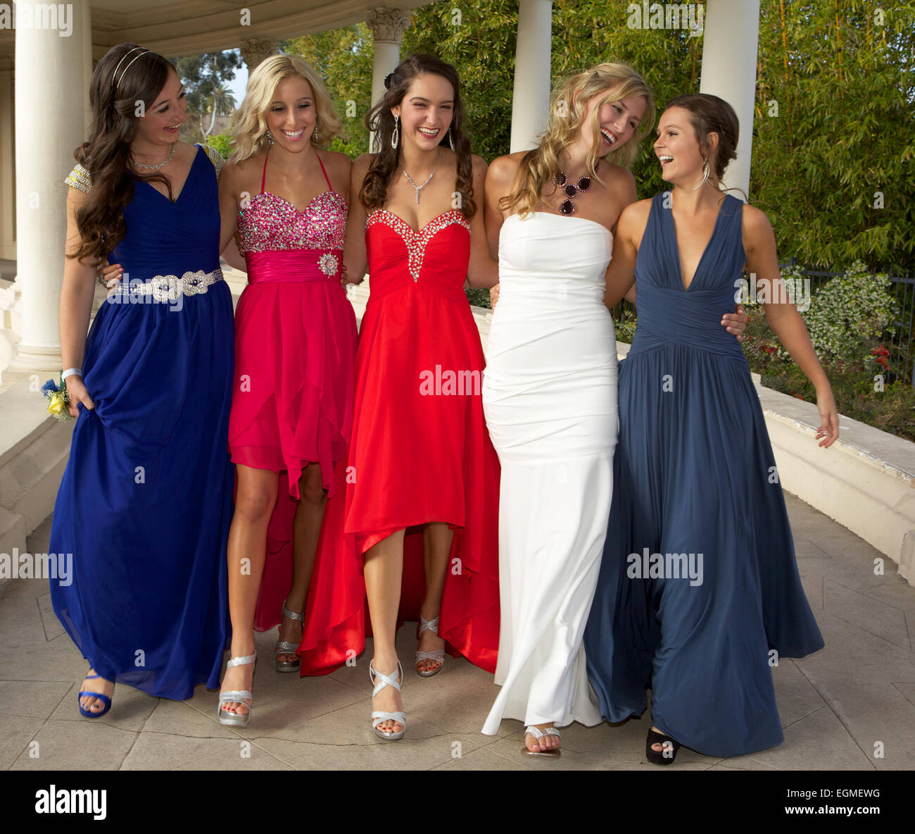 Five Beautiful Teenage Girls In Prom Dresses Walking, smiling and ...