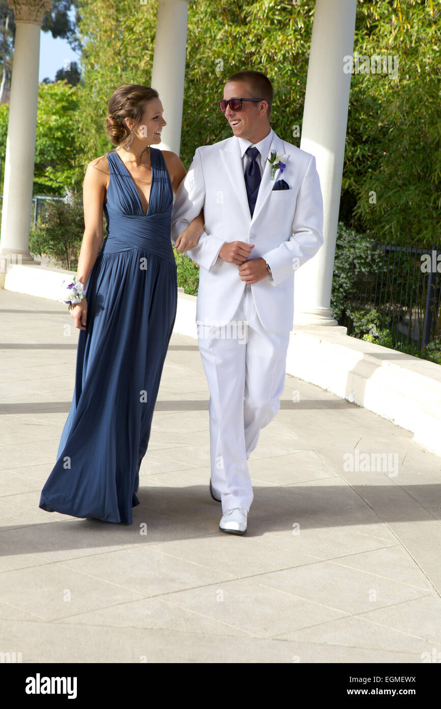 Attractive Teenage Prom Couple Walking in Dress and White Tuxedo ...