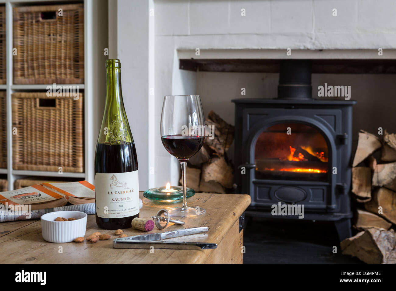 Red wine by the fireside - Stock Image
