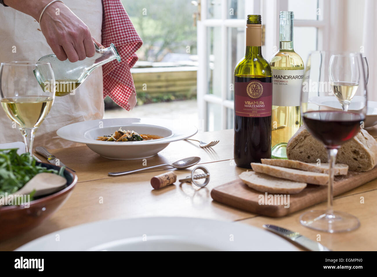 Lunch in the kitchen with wine - Stock Image