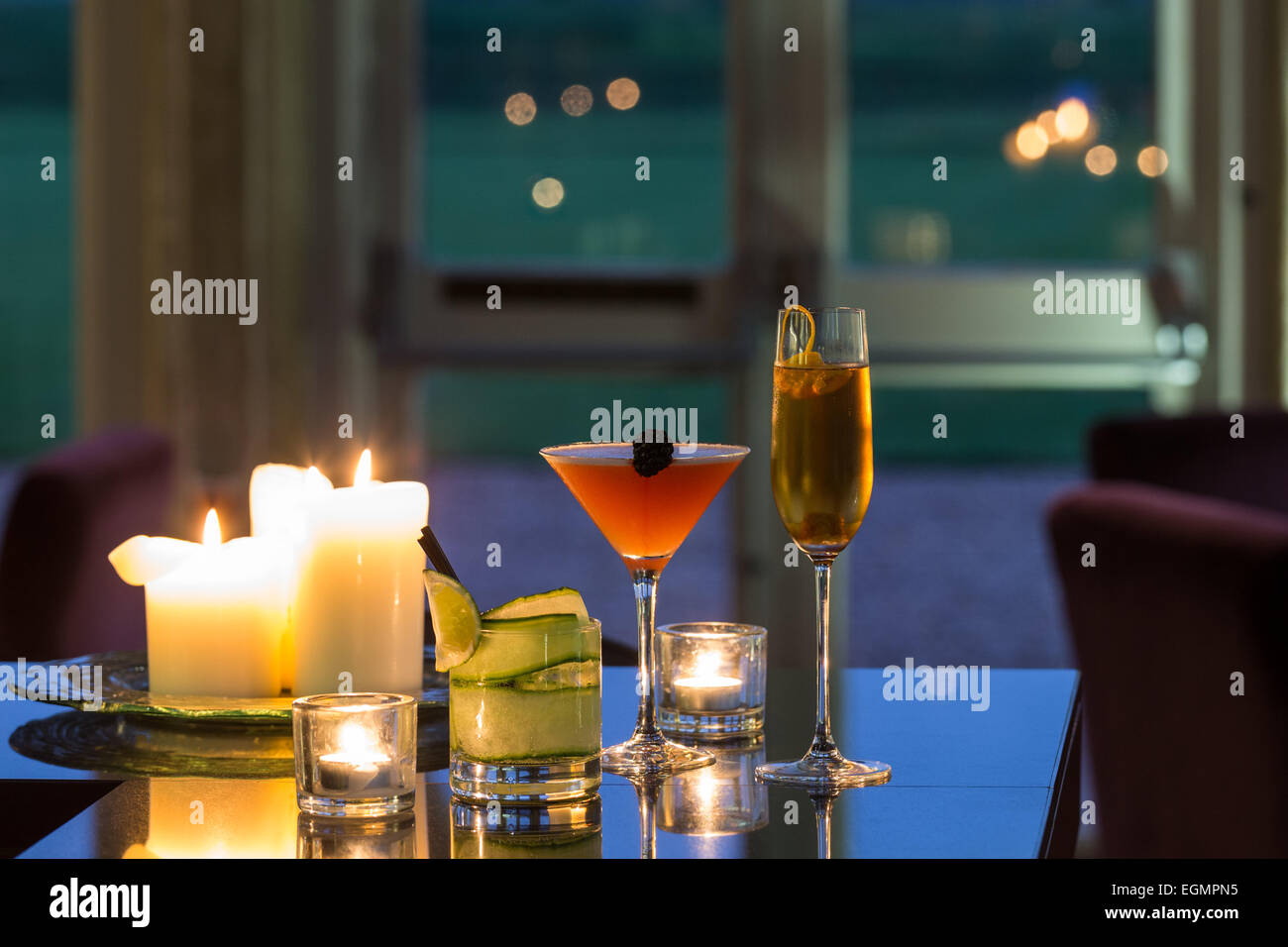 Cocktails on a bar at dusk - Stock Image