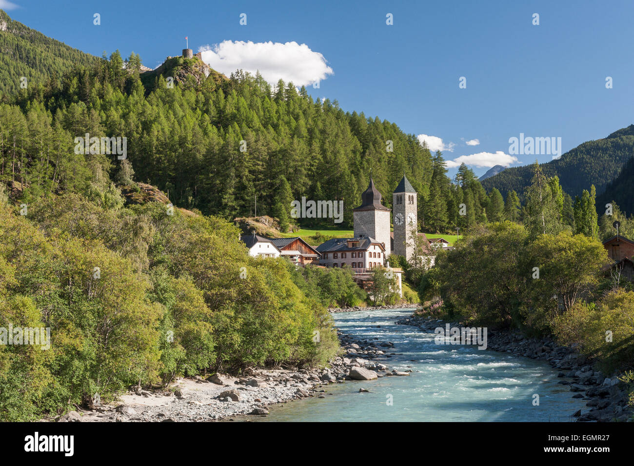 River Inn, medieval Plantaturm Tower with house and Reformed church, Susch, Zernez, Grisons, Switzerland - Stock Image