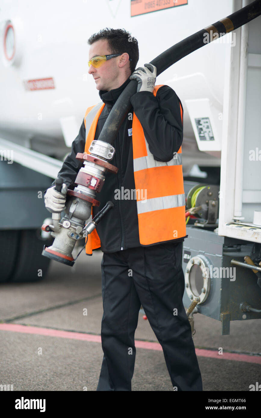 airport worker behind the scenes at Shoreham (Brighton City) Airport, firefighters, airport staff, planes, refueling - Stock Image