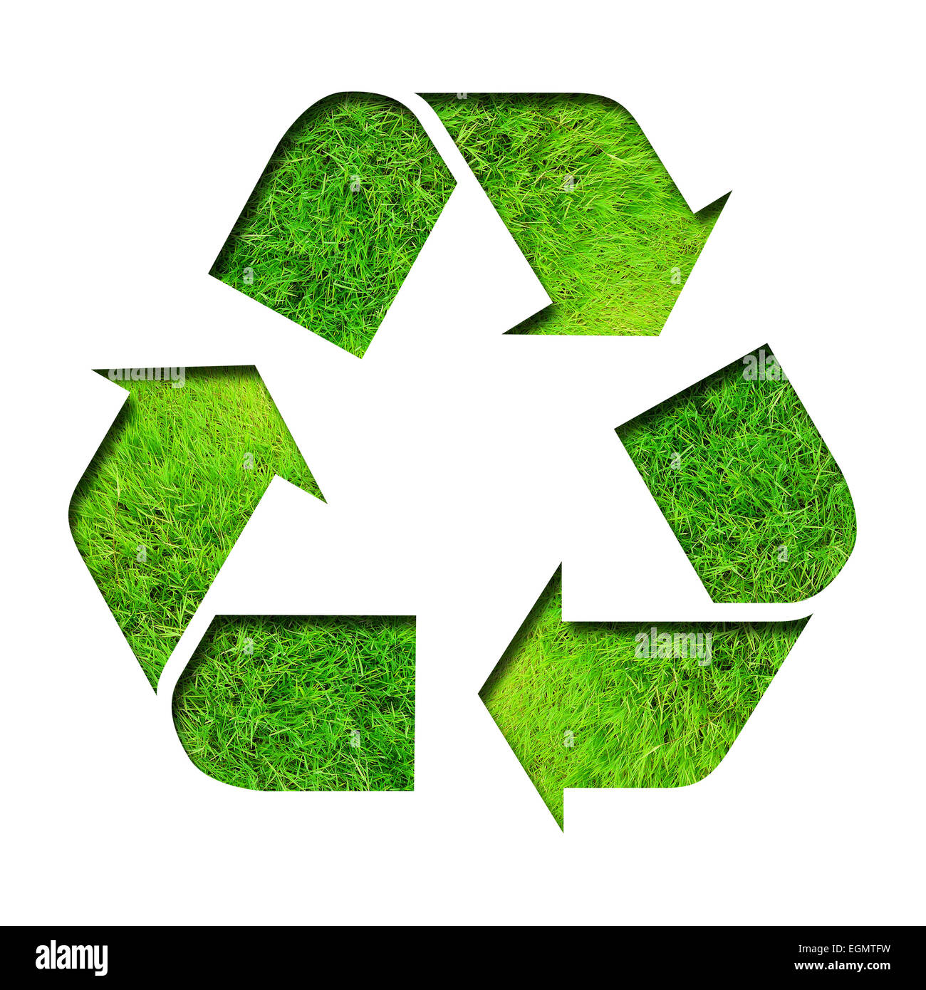 Recycle three arrows sign upon a green grass background, isolated on white - Stock Image
