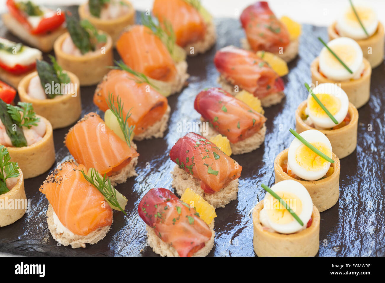 Canapes served on a slate 'plate' - Stock Image
