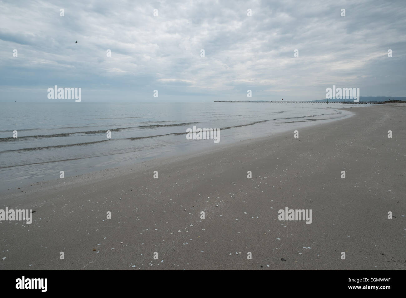Empty gloomy beach on an overcast day. - Stock Image