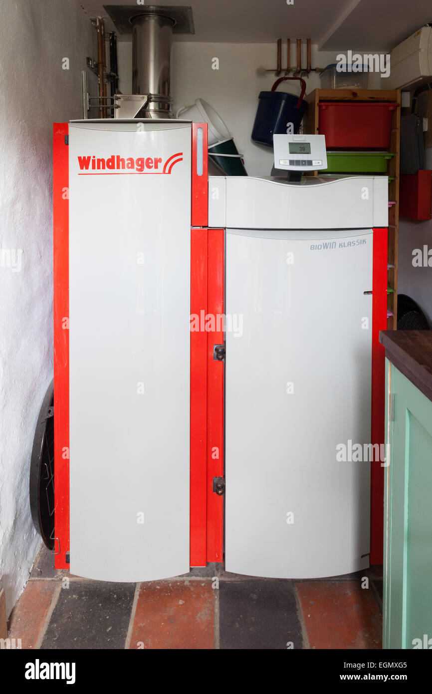 Windhager biomass wood pellet boiler installed in small utility room - Stock Image
