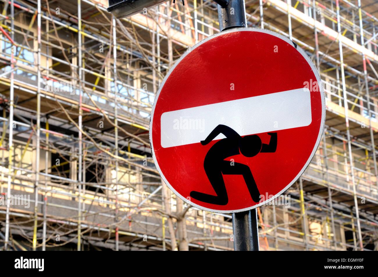 London, England, UK. Street sign in Drury Lane 'added to', probably by Clet Abraham (Feb 2015) - Stock Image
