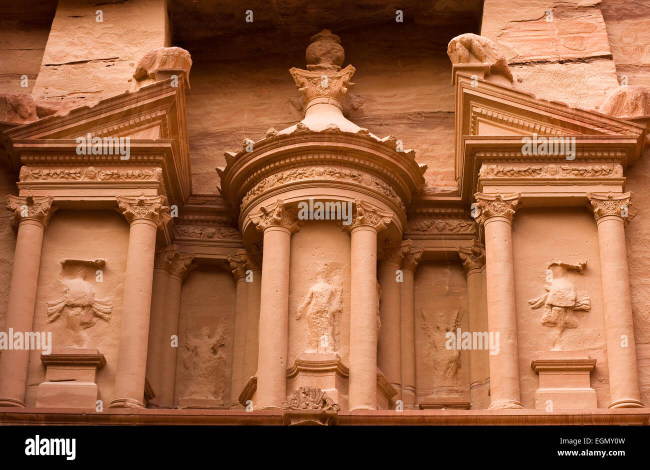 The upper part of the Treasury. The treasury is also called Al Khazna, it is the most magnificant and famous facade Stock Photo