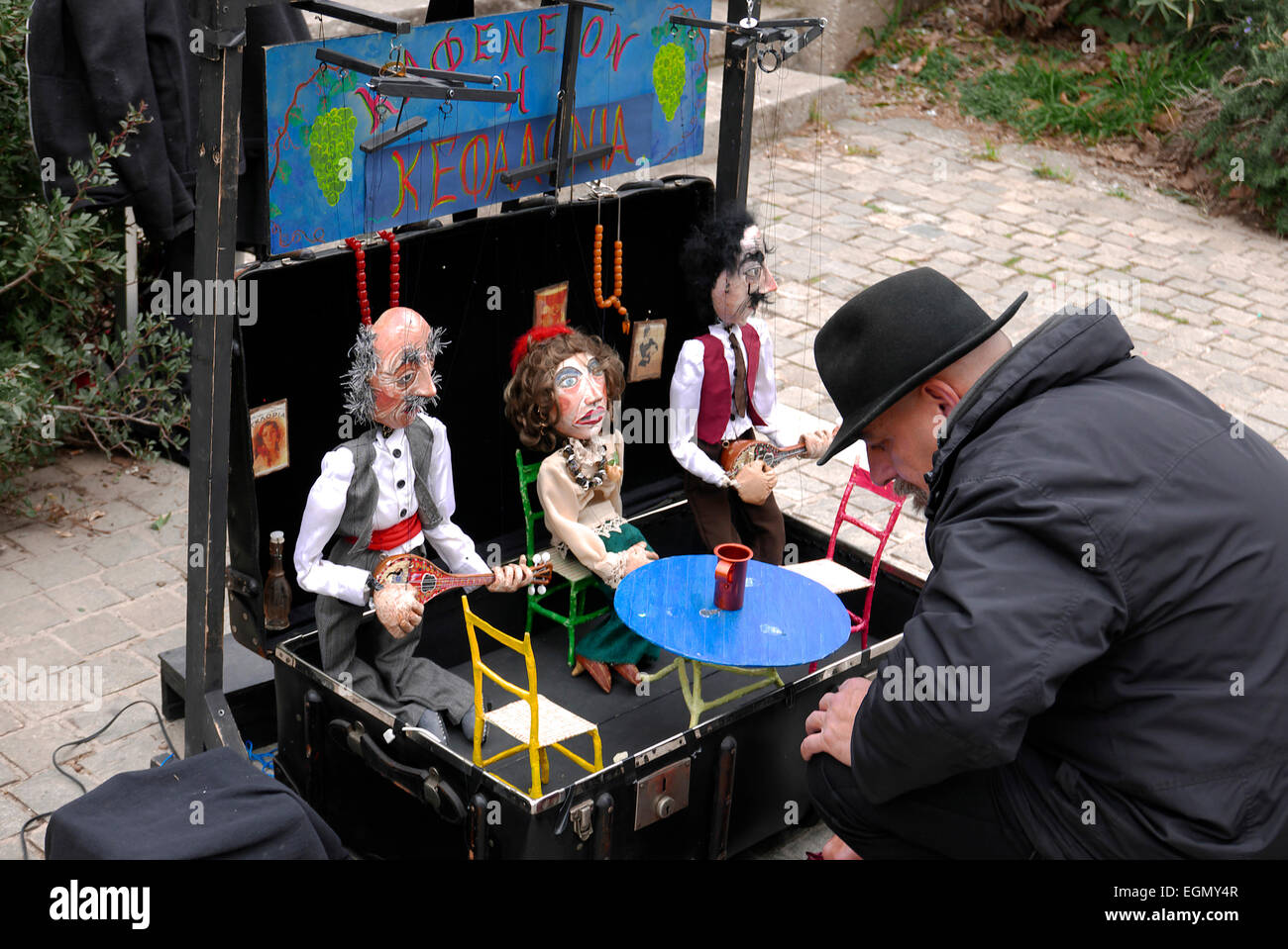 greece attica athens plaka a street performer setting up puppets - Stock Image