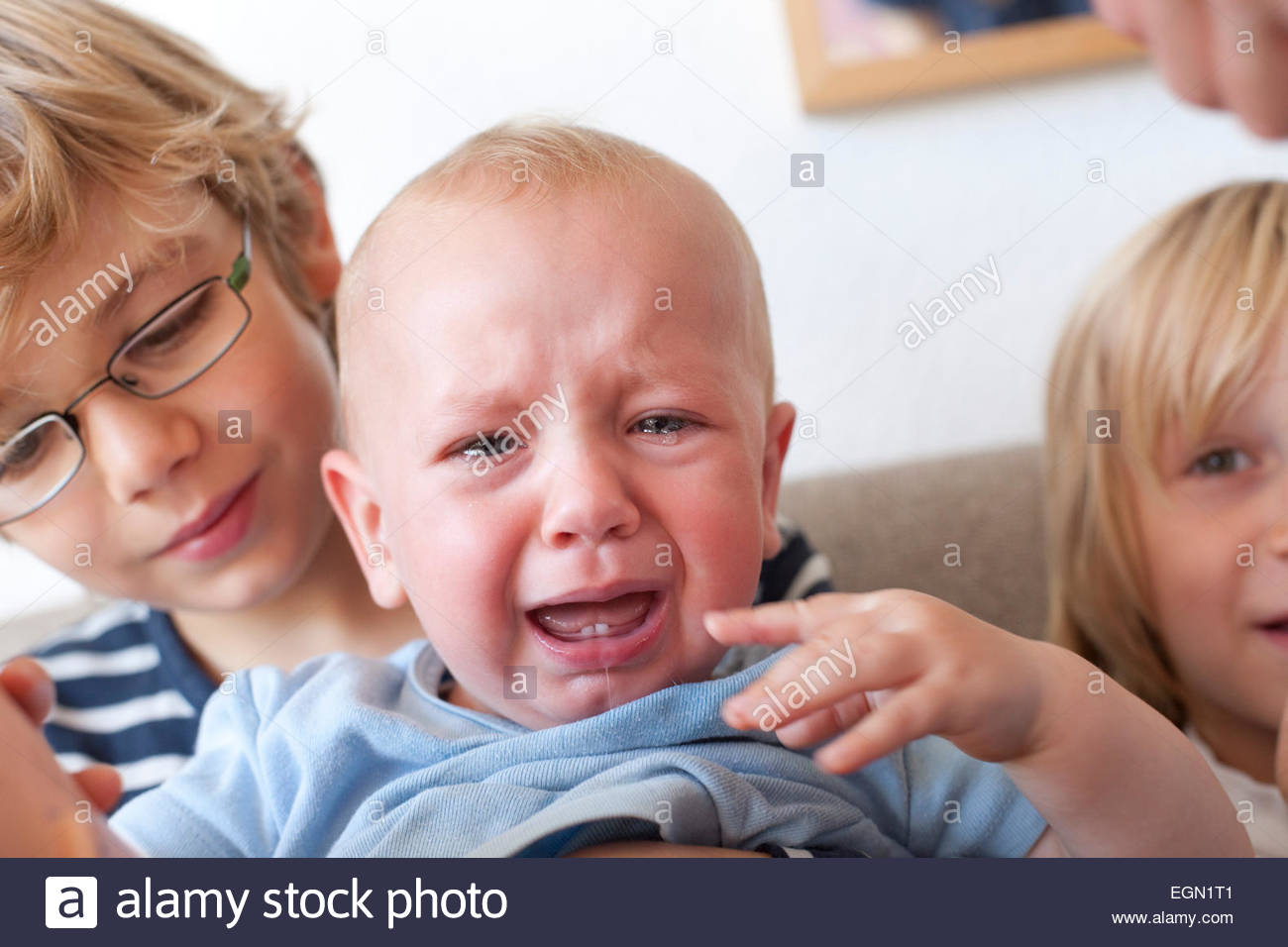 Little brother is crying, Sankt Augustin, Germany - Stock Image