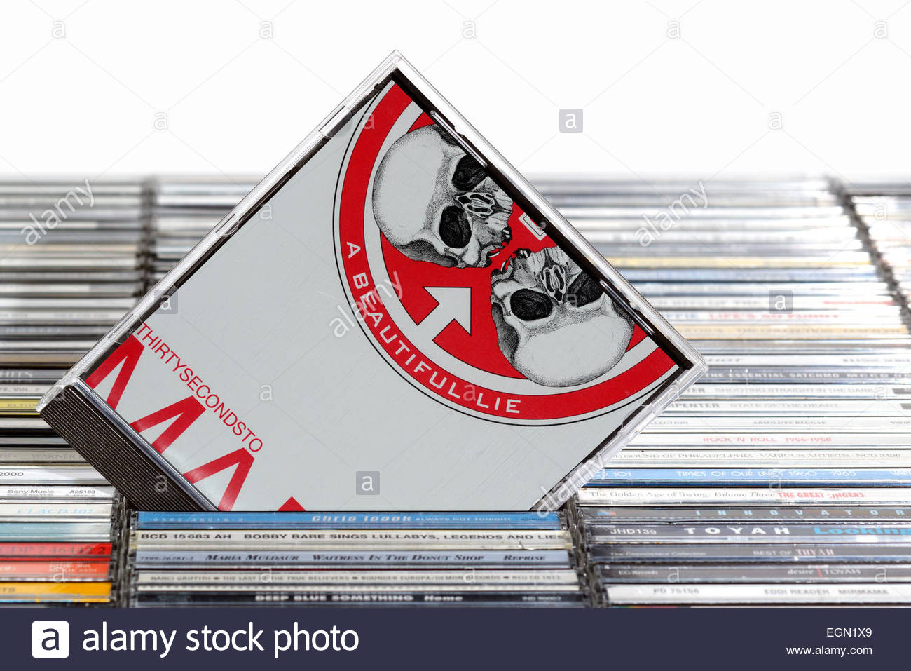 Thirty Seconds to Mars 2007 3rd album A Beautiful Lie, piled music CD cases, England - Stock Image
