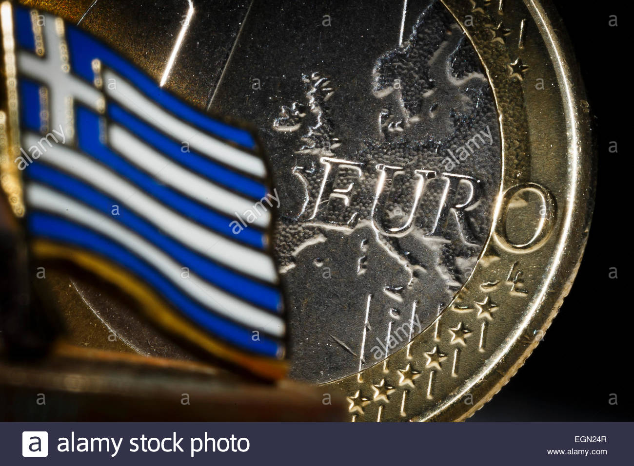 Close-up of a Greek flag with 1 Euro coin - Stock Image