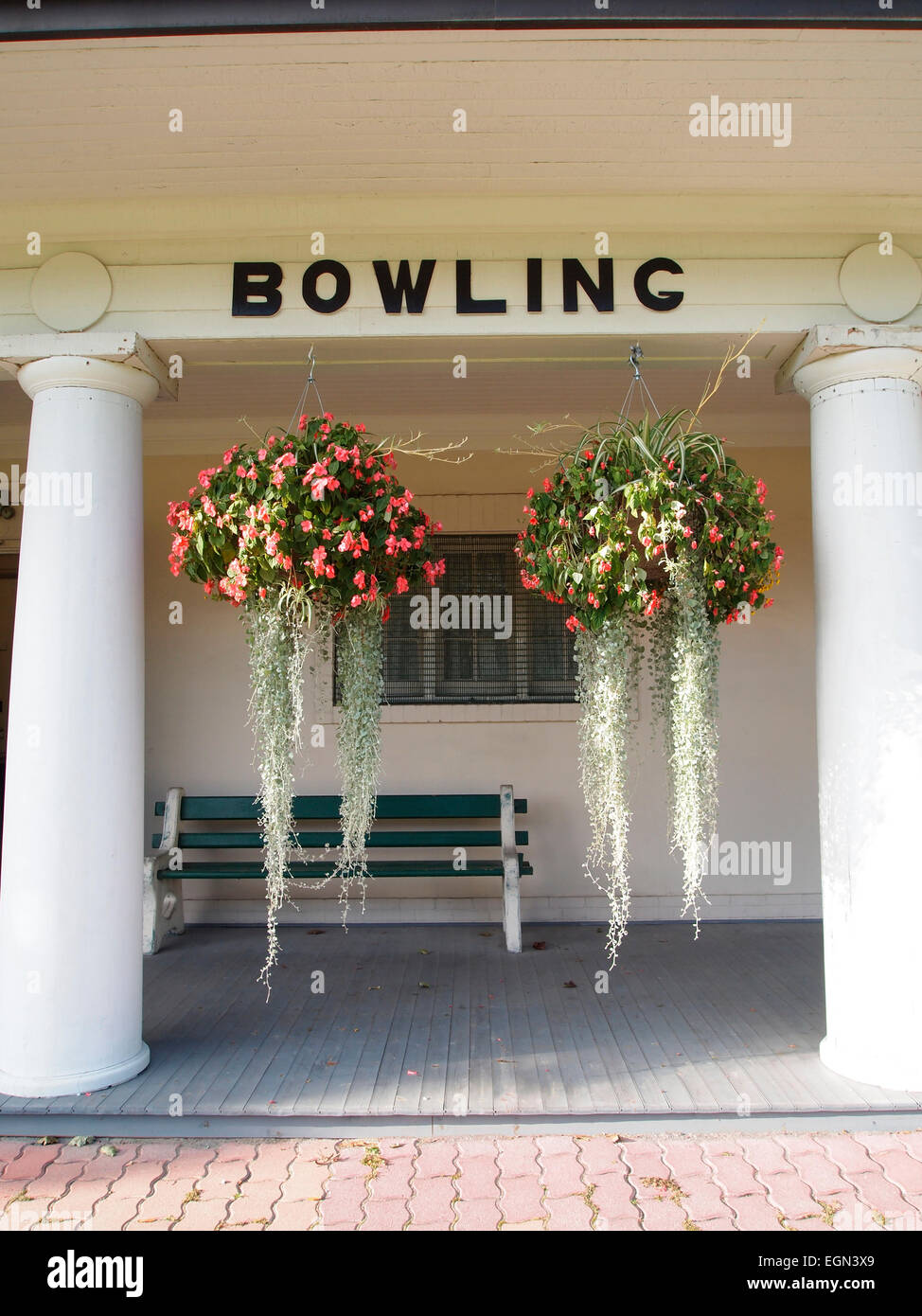 Sign for 'Bowling' at West Toronto Bowling Club's iconic clubhouse – it is in the style of a classical - Stock Image