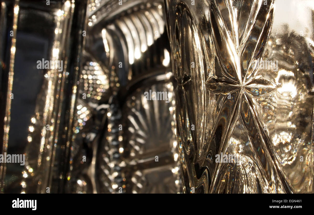 Background image of glass with sunlight, prisms, rainbows, and bokeh. - Stock Image