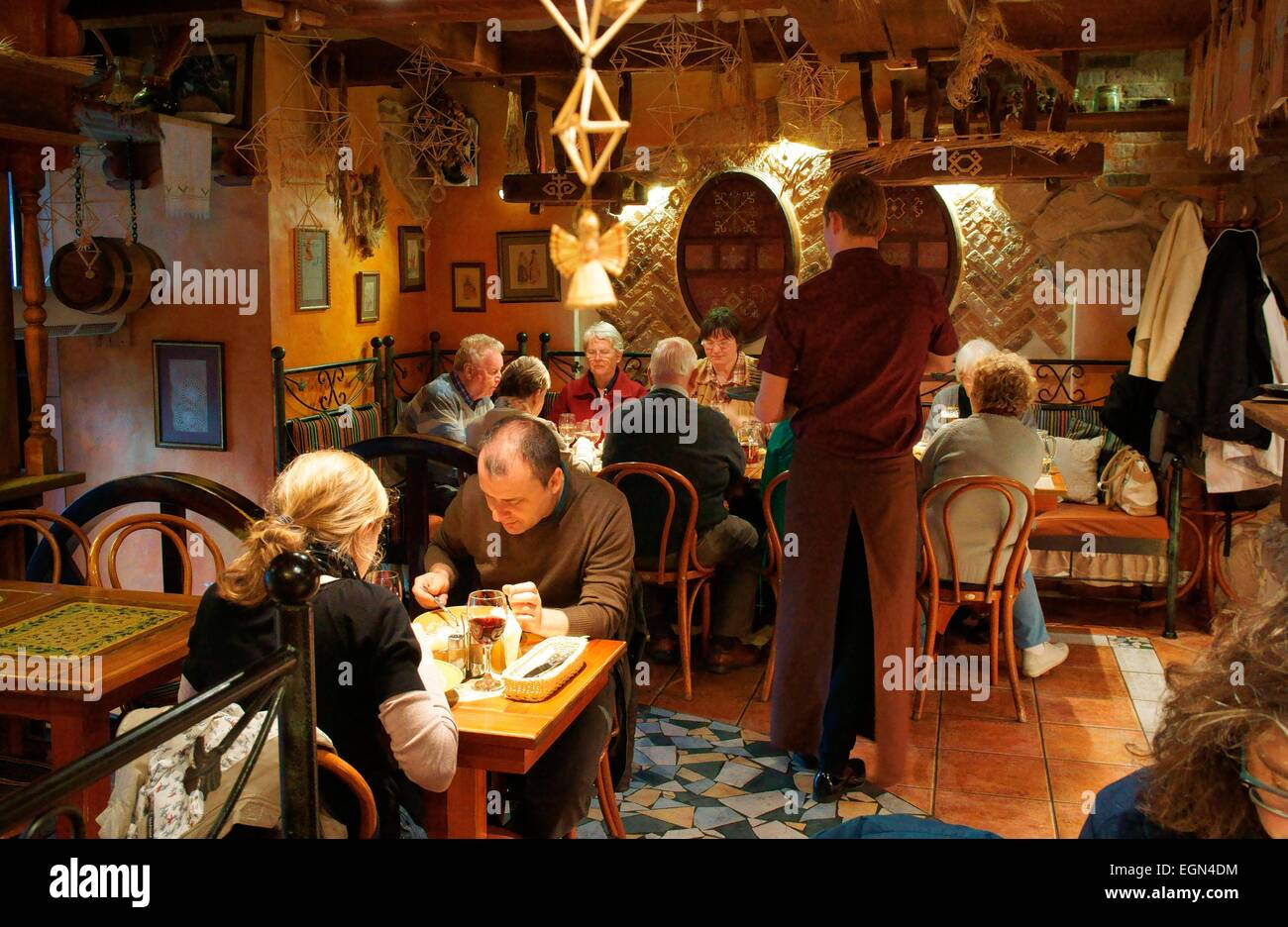 Riga Latvia. Diners and interior of Restaurant Salve on Town Hall Square. Traditional Latvian cuisine - Stock Image