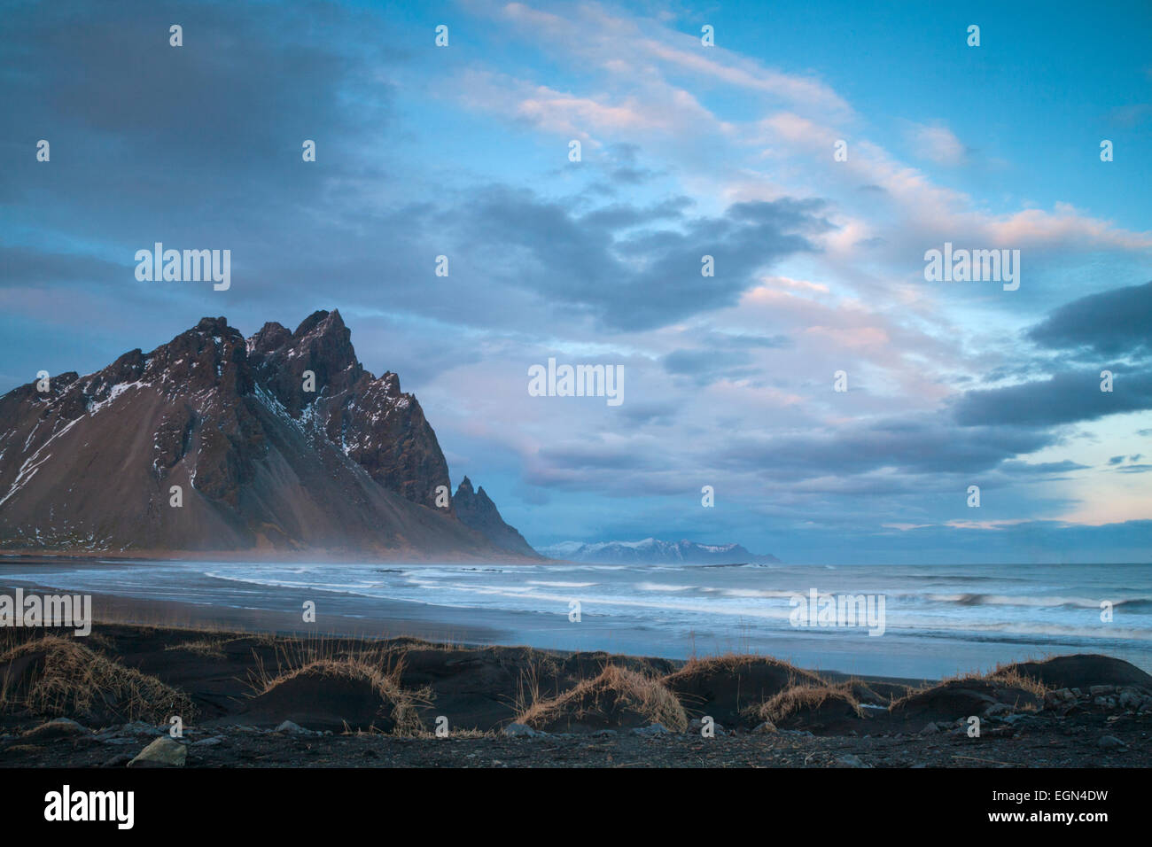 Dramatic scenery with black sand dunes, beach and mountains at Vestrahorn mountains, Hofn, Stokksnes, South Iceland Stock Photo