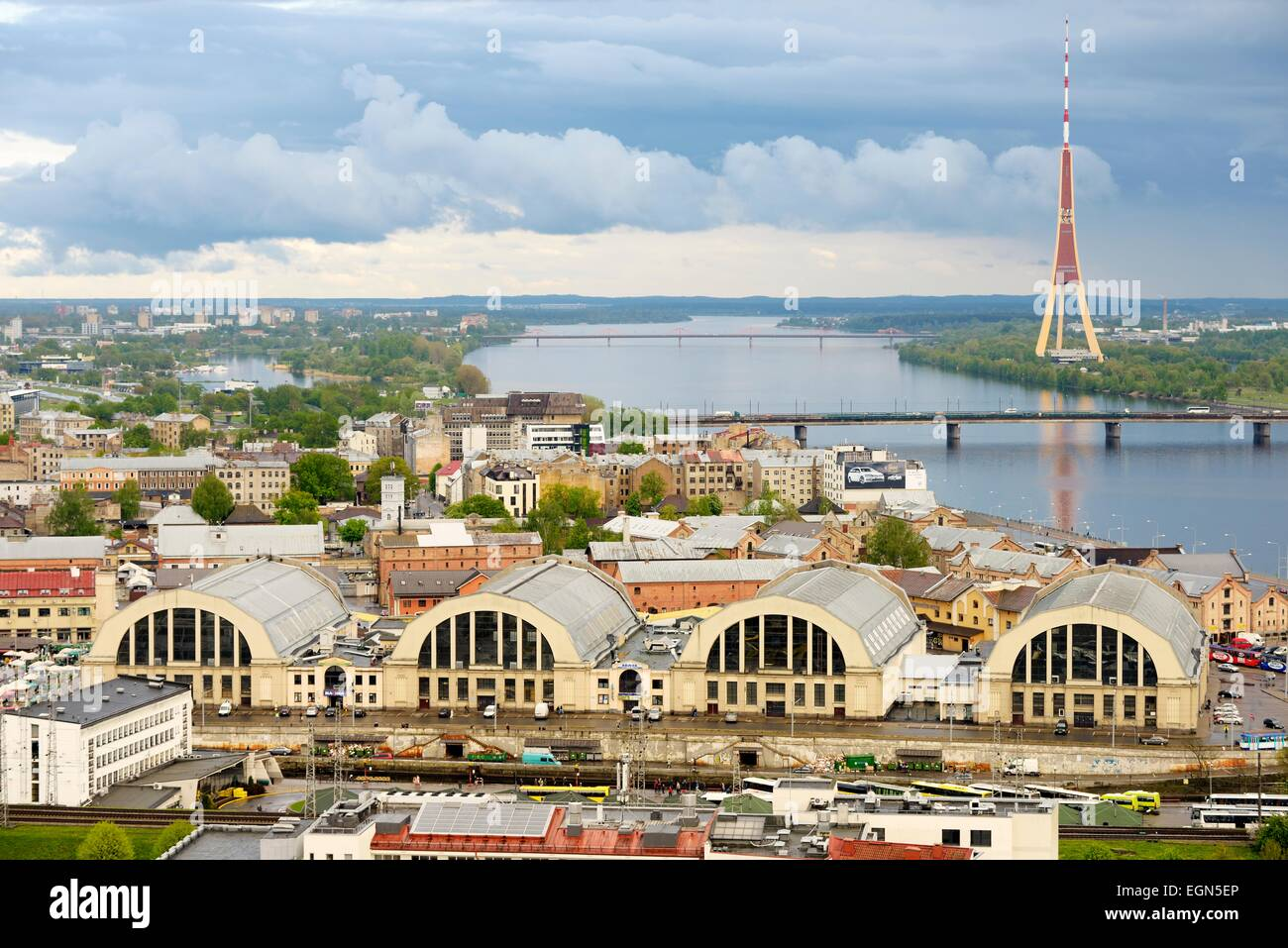 Riga, Latvia. South up the Daugava River to the Television Tower. 4 WW1 Zeppelin hangars now the city market Centraltirgus Stock Photo